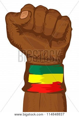 fist wearing a flag of Ethiopia wristband clenched tight