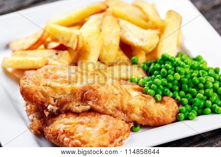British Traditional Fish And Chips With Peas