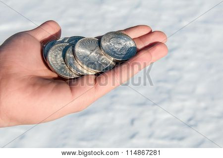 Mexican silver coins in hand