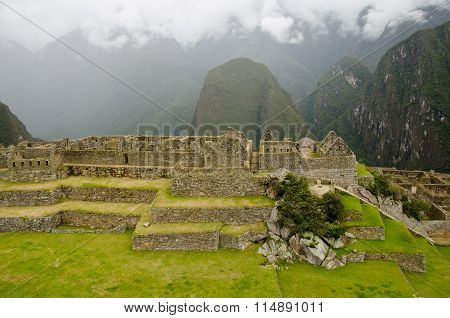 View over the central plaza to the House of Factories in the Industrial Sector of the ancient Inca village Machu Picchu Peru