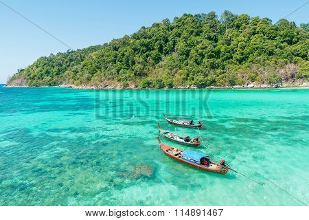 Tropical beach longtail boats Andaman Sea in Phuket Thailand
