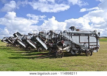 Lineup of old threshing machines