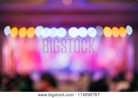 Blurred background : Bokeh lighting in concert with audience Music showbiz concept vintage filtered image.