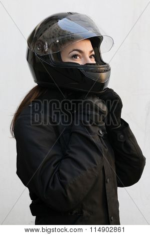 The Motorcyclist Girl  In Black Tie A Helmet