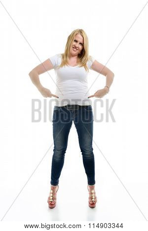 Overweight young woman pointing at her belly, over white background.