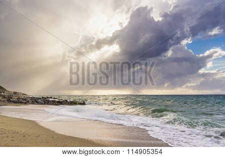 Nice beach with sea view, waves of water and clouds on sky