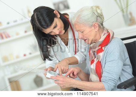 Senior woman organising her medication