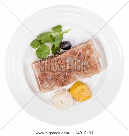 Top View Of Piece Of Meat Aspic On White Plate