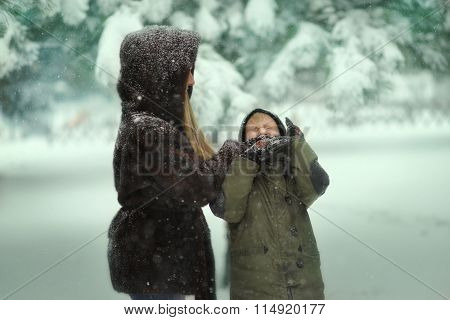 Winter In The Park Playing Mother And Son In The Snow