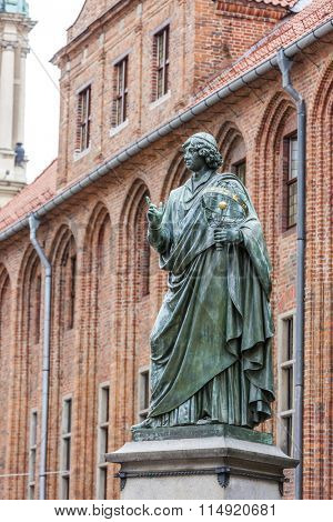 Nicolaus Copernicus monument in front of city hall of Torun, Rynek Staromiejski, Kuyavia-Pomerania, Poland