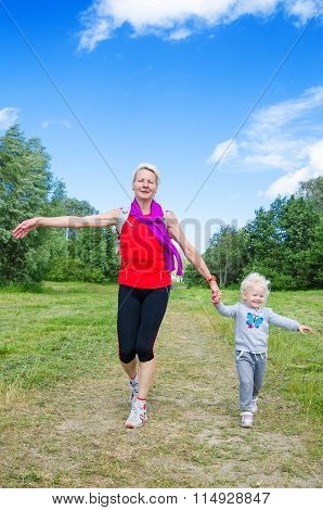 A Woman With A Child On The Sports Outing