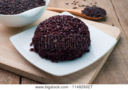 Black Rice Cooked On White Plate And Black Rice Grains Organic.