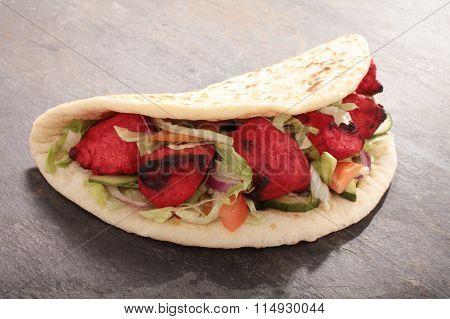 food photos of indian tikka shish donner wrap sandwich