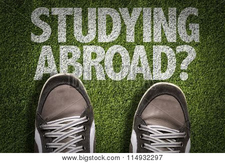 Top View of Sneakers on the grass with the text: Studying Abroad?