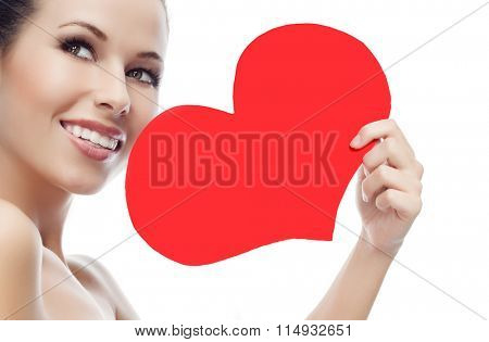 beauty portrait of attractive  caucasian smiling young woman isolated on white studio shot face skin red heart valentine's love
