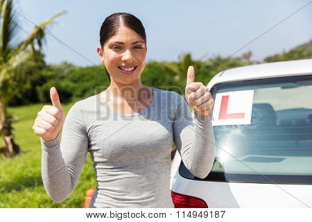 pretty young student driver thumbs up