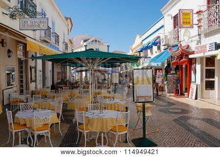 View to the pedestrian street with restaurants in Lagos, Portugal.