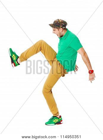 Fullbody Portrait Of Young Male Kicking In Studio Isolated On White.