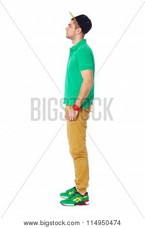 Fullbody Profile Portrait Of Young Man Standing In Studio Isolated On White.