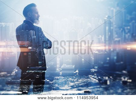 Double exposure photo a businessman and view of the city