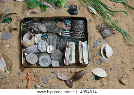 Ancient treasure of coins and gold in sand