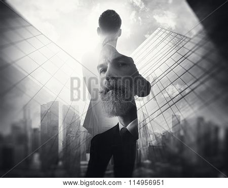 BW portrait of bearded gentleman in suit. Double exposure skyscraper on the background.
