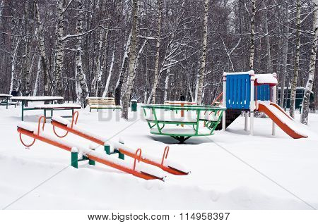 Children Playground In Snow