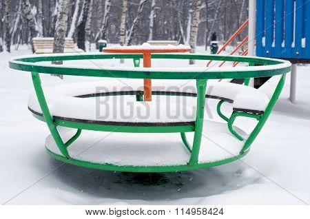 Children Green Round Swing In Snow