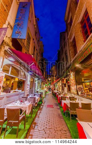 BRUSSELS, BELGIUM - 11 AUGUST, 2015: Famous street Rue des Bouchers with its fantastic charm and tig