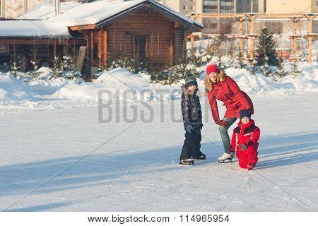Happy Family Skate In The Winter