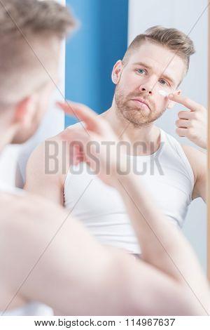 Man Applying Cream