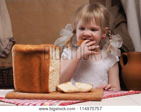 Child eating freshly baked bread