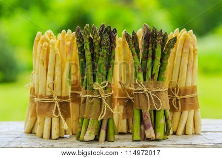 Asparagus - bunches of white and green asparagus