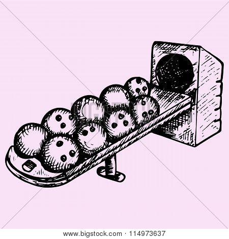 bowling balls sitting in the ball return