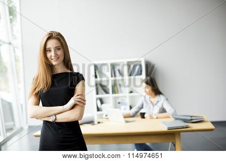 Two pretty young women working in the office