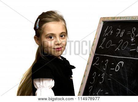 Smiling Schoolgirl Standing Near The Blackboard