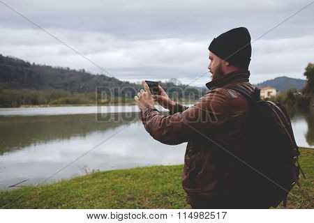 Bearded man shoots video on cell telephone during amazing travel through the countryside