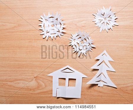 Paper Snowflakes, House And Christmas Tree On Wooden