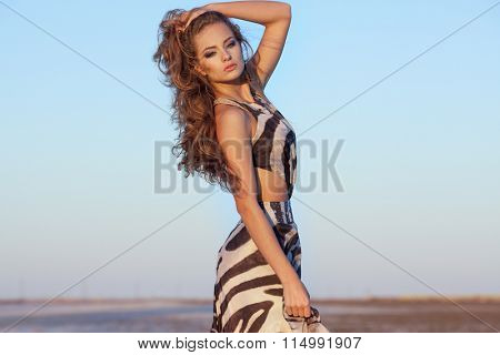Beautiful young woman in a dress