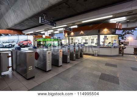 Ticket office corner and ticket barrier machine at the BTS public train station at night