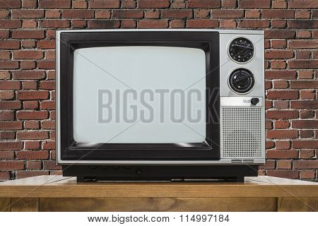 Analog television with brick wall.