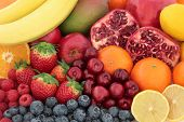 Fresh mixed fruit superfood background with fruits high in antioxidants, vitamin c and dietary fibre. poster