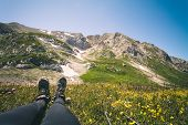 Feet Woman trekking boots relaxing outdoor Travel Lifestyle concept mountains on background Summer vacations poster