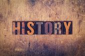 "The word ""History"" written in dirty vintage letterpress type on a aged wooden background. poster"