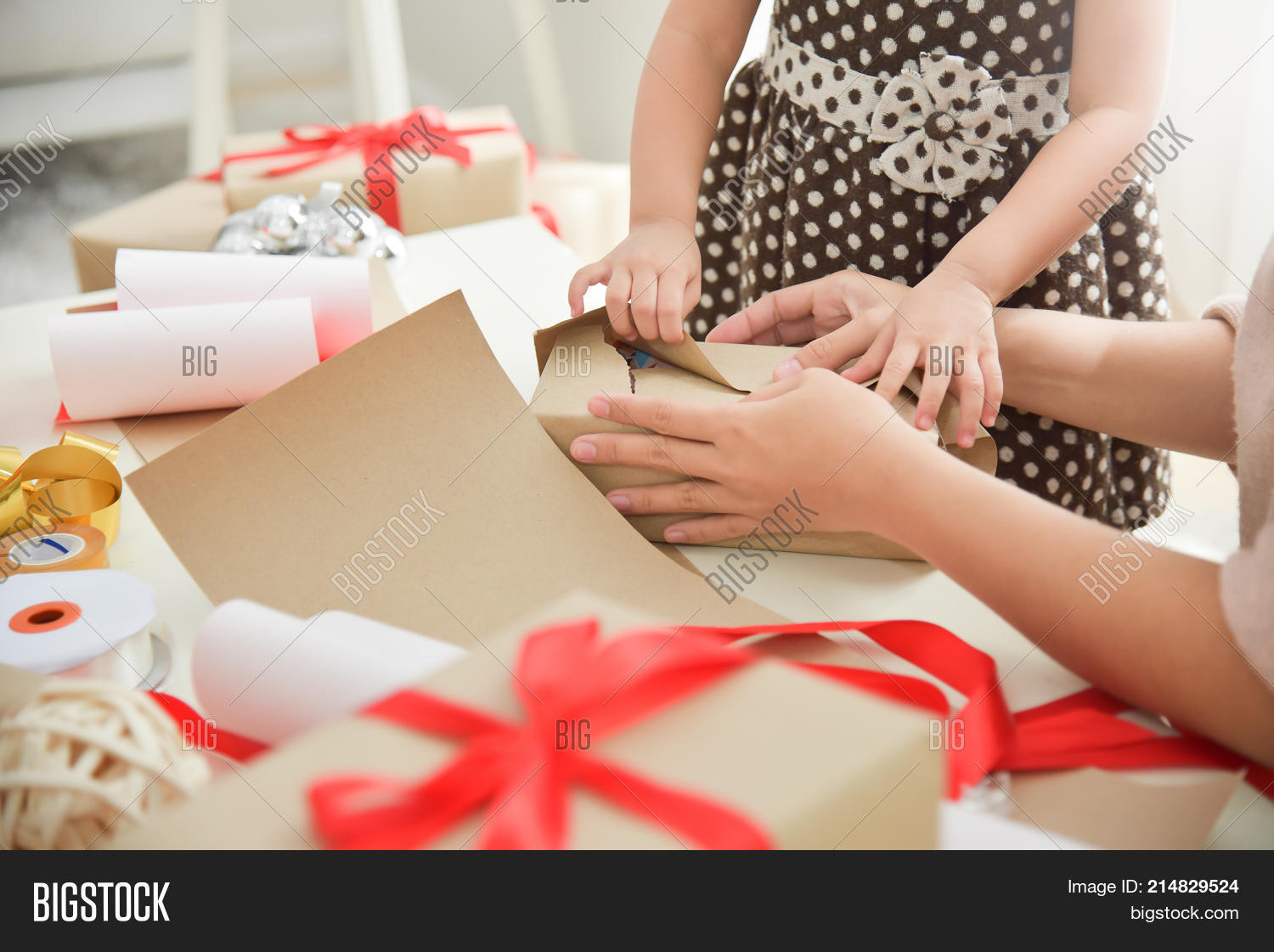 Closeup Young Mother And Her Daughter Hands Wrapping A Gift Box For Birthday Christmas New