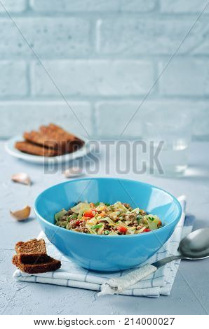 Cabbage minced beef ragu on a stone background