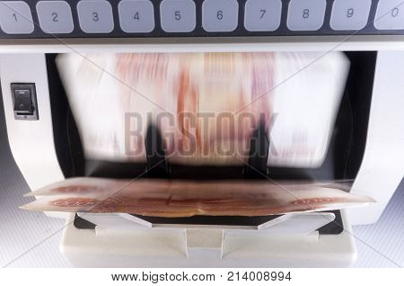 electronic money counter machine is counting the Russian five-thousandth ruble banknotes blurry effect of the movement