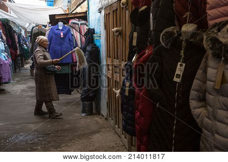 OLGIY, BAYAN-OLGIY, MONGOLIA - SEP 27, 2017: Unknown woman in the city market sells clothes. In Bayan-Olgiy province is populated to 88,7% by Kazakhs.