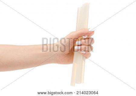 Stem for glue gun in hand on white background isolation