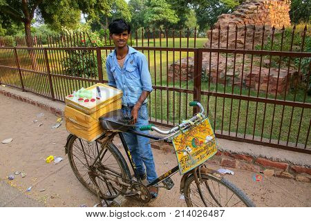 Fatehpur Sikri, India-november 9: Unidentified Man Sells Desserts From A Bicycle Outside Jama Masjid